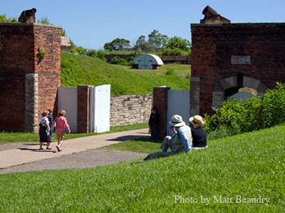 Tourists spend a sunny day at Historic Fort Wayne, one of Michigan's historic sites with Civil War history.